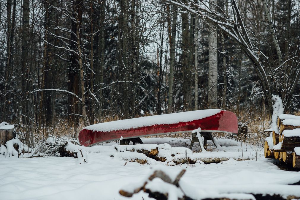 red canoe in the snow