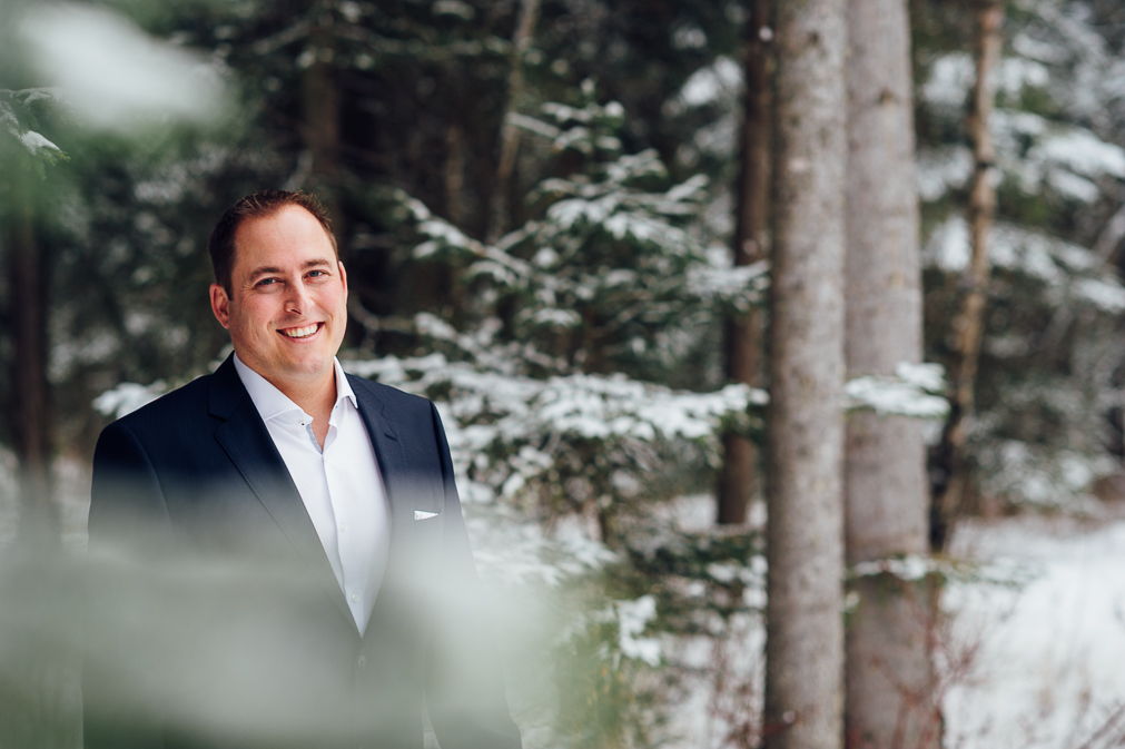 groom portrait in the snow
