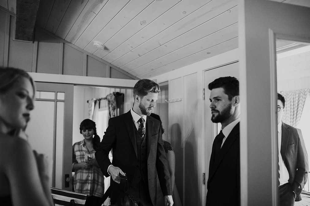 bride and groom get ready in a cabin