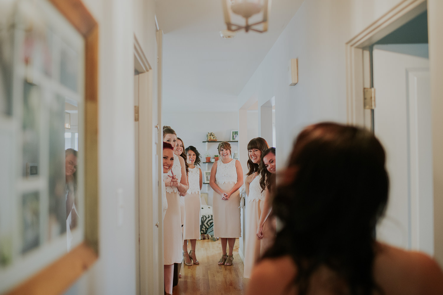 brides first look with bridesmaids