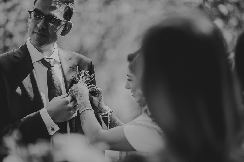 bride putting on boutonniere