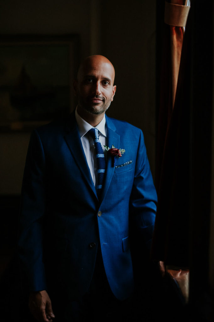 moody groom portrait