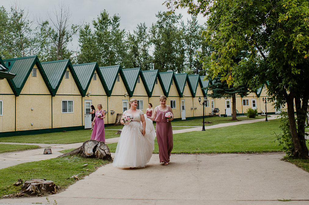 bride walks to ceremony at lily lake resort