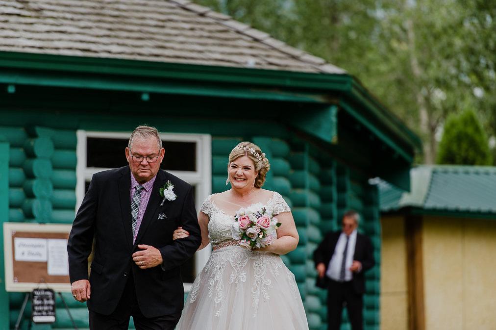 groom cries while bride walks down aisle