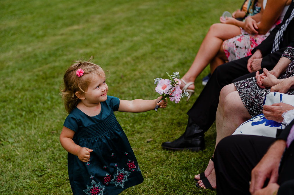candid moment with flower girl at wedding