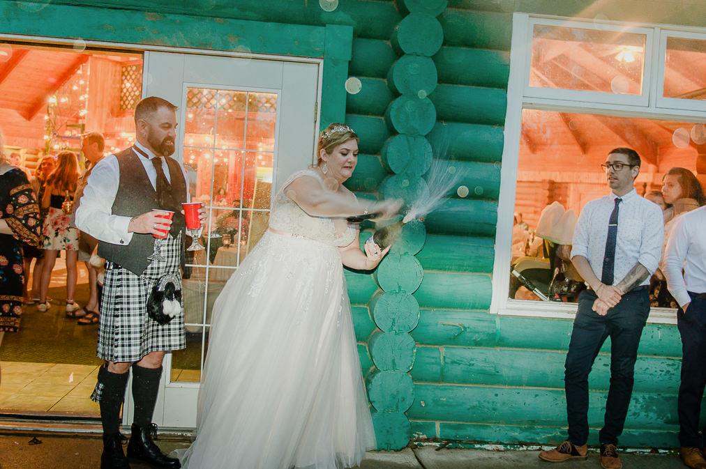 bride sabres a bottle of wine